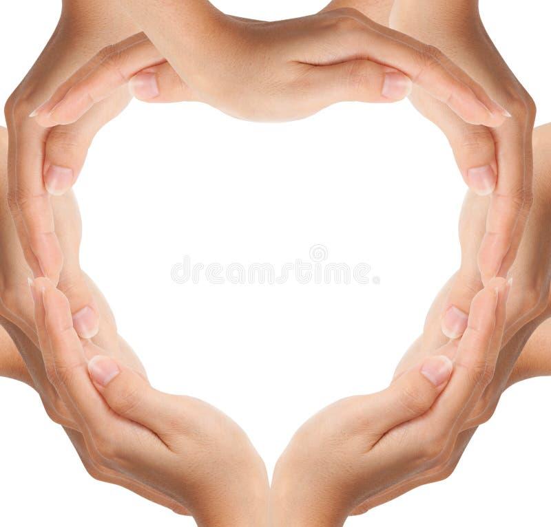 Le mani fanno la figura del cuore fotografia stock