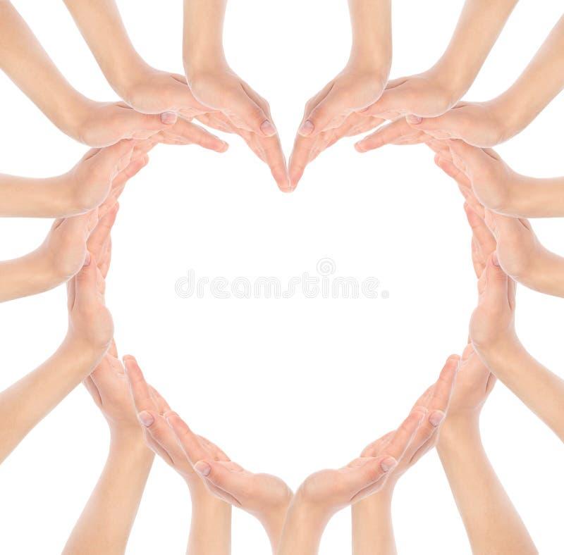 Le mani fanno la forma del cuore fotografia stock libera da diritti