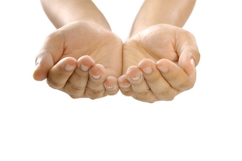 Le mani gradicono tenere qualcosa immagine stock libera da diritti