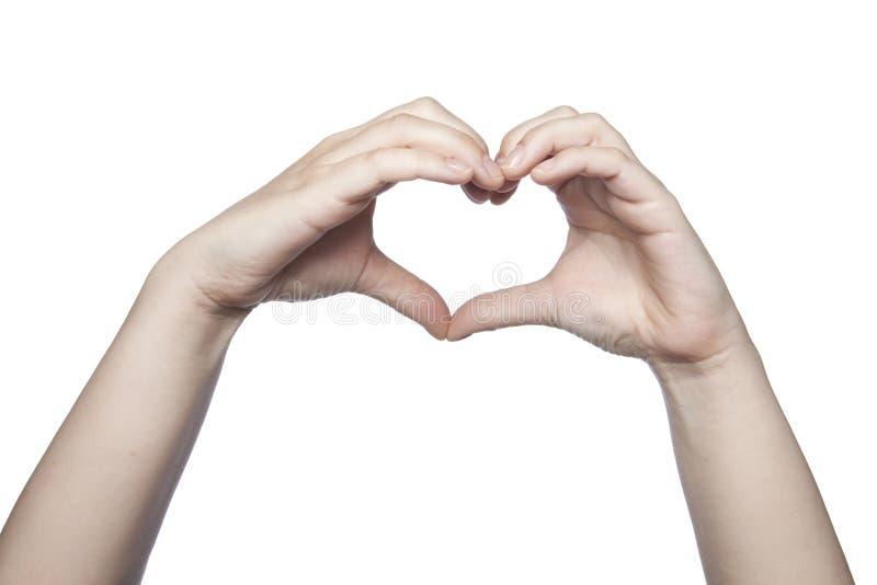 Le mani piegate sotto forma di un cuore indicano l'amore, copiano la stazione termale immagine stock