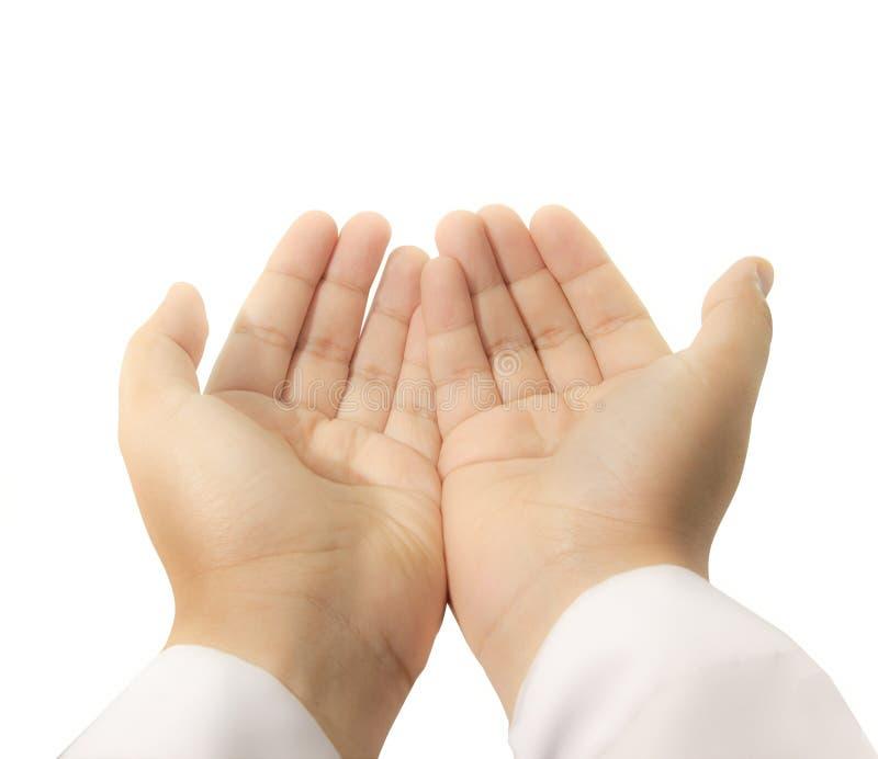 Le mani si sono alzate in su per pregare immagini stock libere da diritti