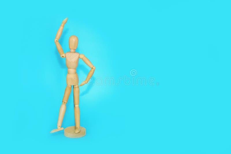 Le mannequin en bois montre des émotions et des mouvements photos stock