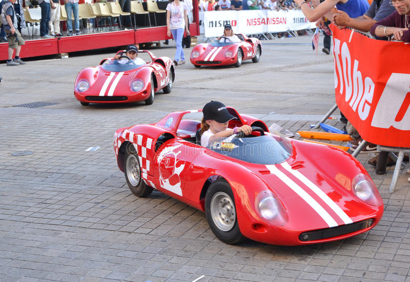LE MANS, FRANCE - JUNE 13, 2014: Childrens on sports cars on Parade of pilots racing royalty free stock image