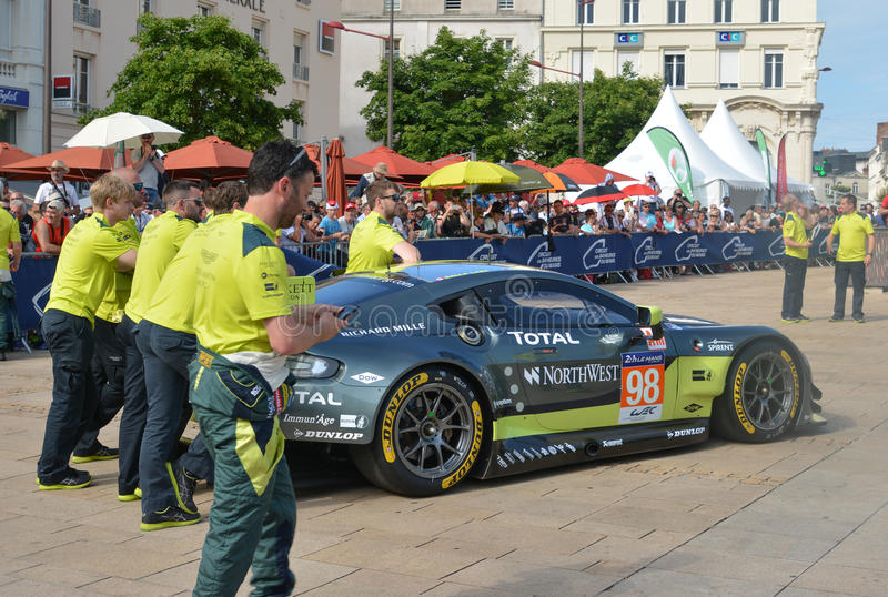 LE MANS, FRANCE - JUNE 11, 2017: Famous English racer Darren Turner with his team and Aston Martin Vantage racing car. Weighing, a stock photo