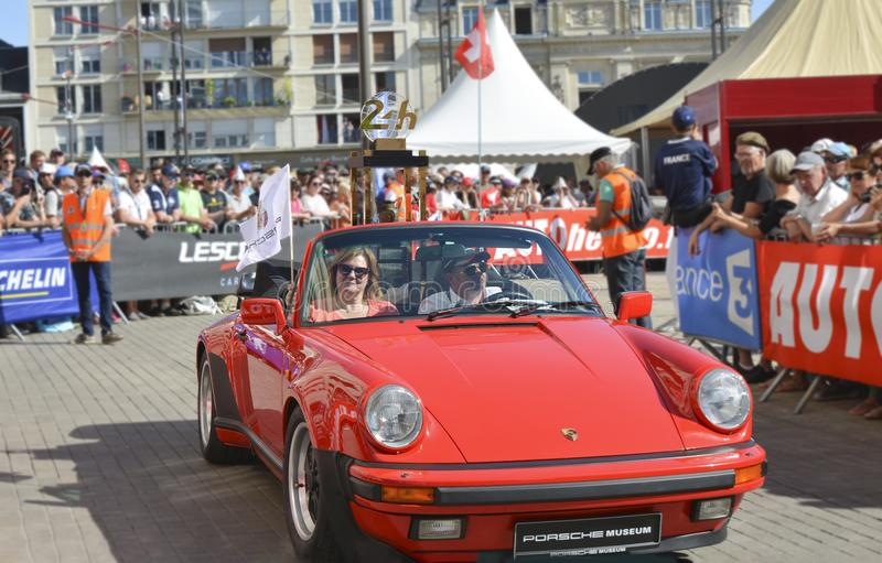 LE MANS, FRANCE - JUNE 16, 2017: Sports red porsch with gold trophy of a race of 24 hours of Le mans at the parade of pilots racin. LE MANS, FRANCE - JUNE 16 royalty free stock images