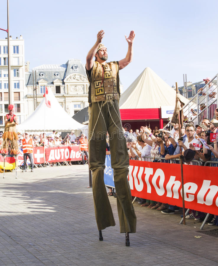 LE MANS, FRANCE - JUNE 16, 2017: street circus actors go on stilts at the opening parade of 24 hours of Le mans stock photos