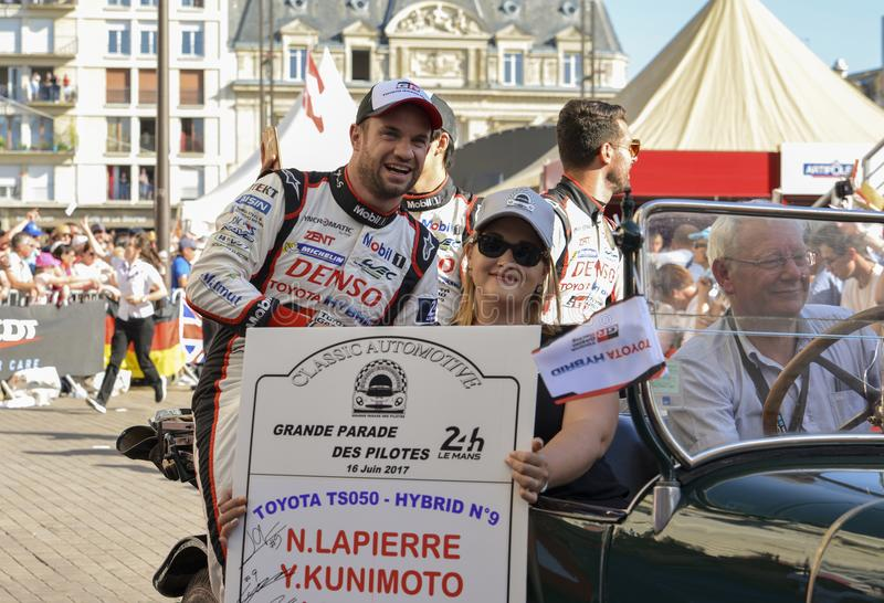 LE MANS, FRANCE - JUNE 16, 2017:Team of Toyota Racing Toyota TS050, drivers Y.Kunimoto - M. Lopez - N. Lapierre at a parade of pil stock photo