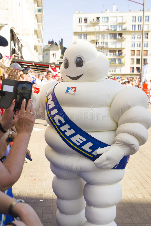 LE MANS, FRANCE - JUNE 16, 2017: White inflatable man - emblem of the company Michelin on a parade of pilots racing. At Le mans, France stock photography