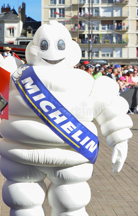 LE MANS, FRANCE - JUNE 16, 2017: White inflatable man - emblem of the company Michelin on a parade of pilots racing. At Le mans, France royalty free stock photo