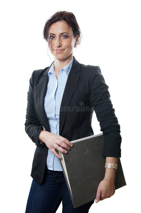 Mapp för affärskvinnainnehav arkivfoto