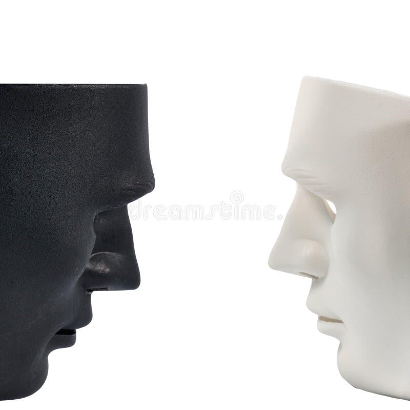 Le maschere in bianco e nero gradiscono il comportamento umano, concezione fotografia stock libera da diritti