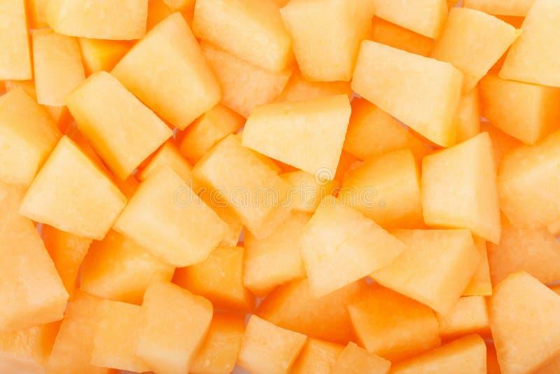 Le melon de cantaloup rapièce le fond photo stock