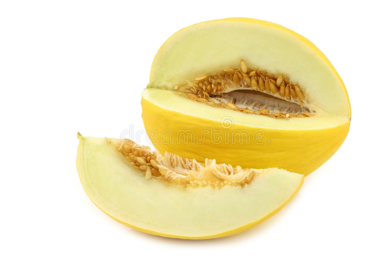 Le melon jaune frais de miel et une coupe rapiècent photographie stock libre de droits