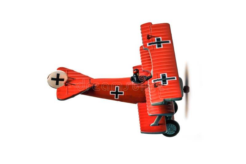 Le modèle rouge d'avion de baron a capturé d'isolement de l'arrière photo libre de droits