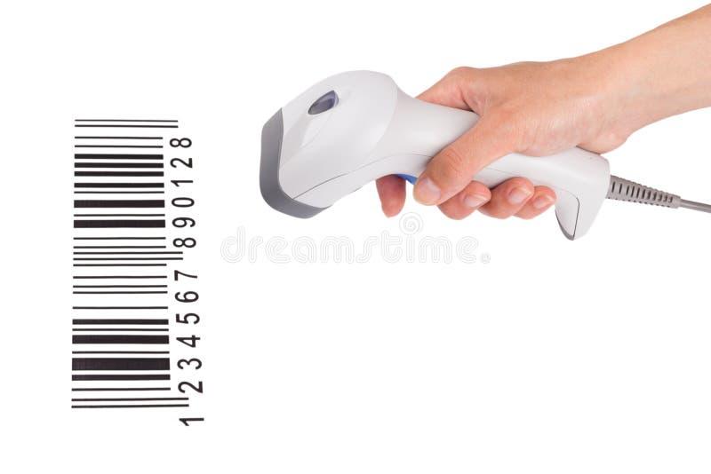 Le module de balayage manuel du code à barres dans une main femelle photos libres de droits