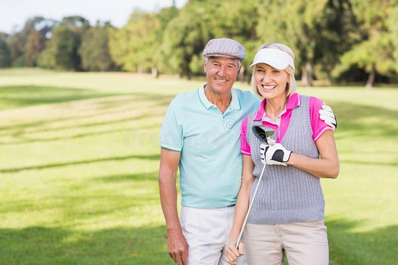 Le moget paranseende på golfbanan royaltyfri foto