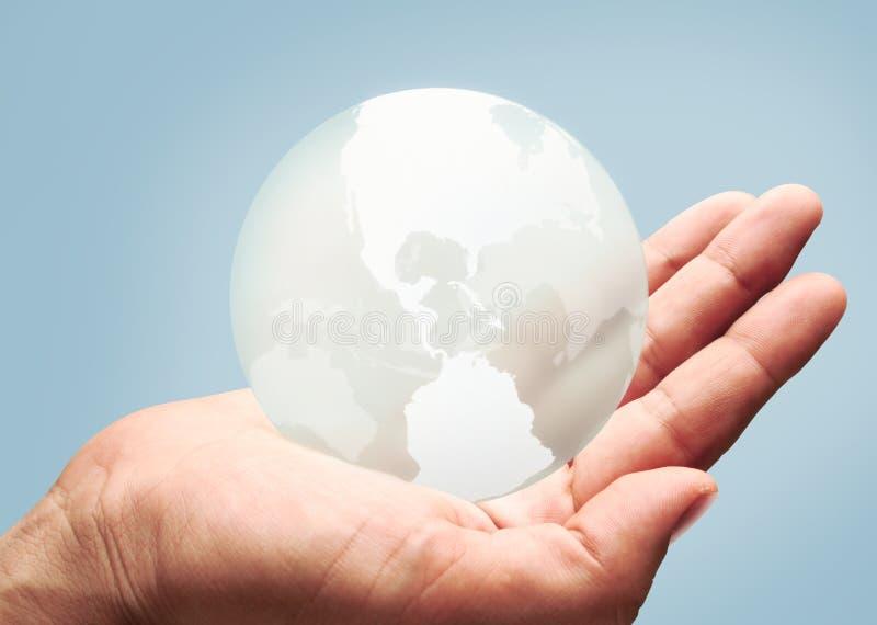 Le monde dans des vos mains images libres de droits