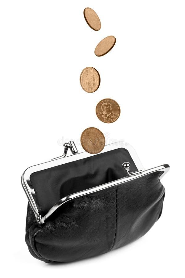 Le monete che cadono nel cambiamento si increspano   fotografia stock