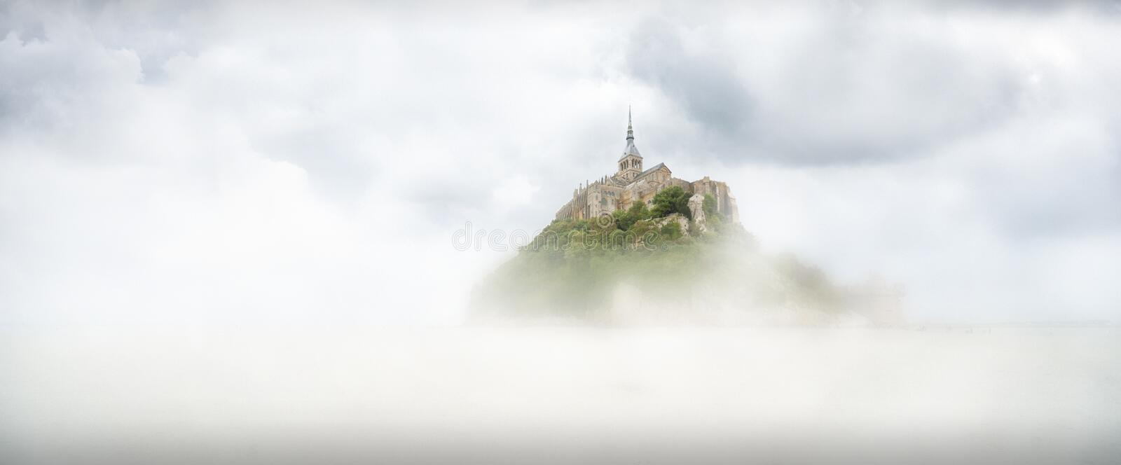 Panoramic view of the famous tidal island of Le Mont Saint-Michel on a fog day, Normandy, northern France stock image
