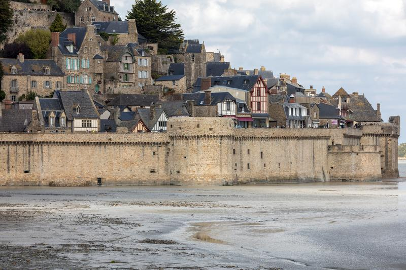 Le Mont Saint-Michel, medieval fortified abbey and village on a tidal island in the Normandy, France, royalty free stock photography