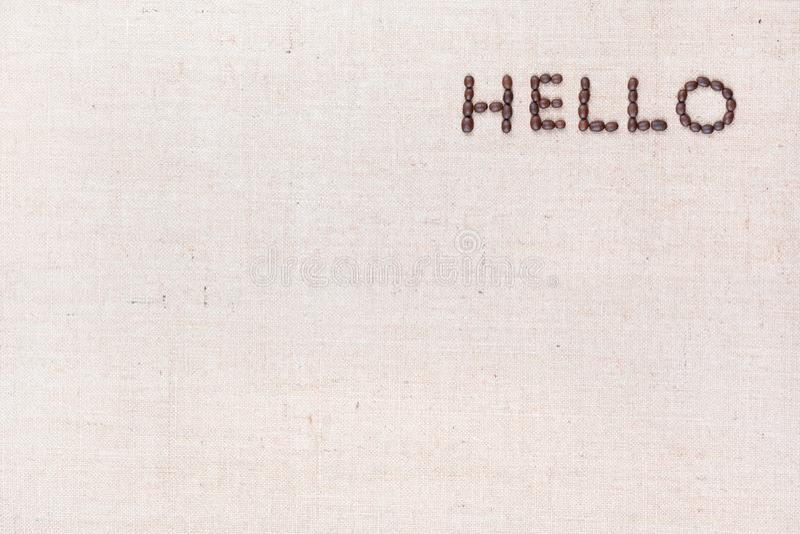Le mot bonjour écrit avec des grains de café tirés d'en haut, aligné à l'en haut à droite photo stock
