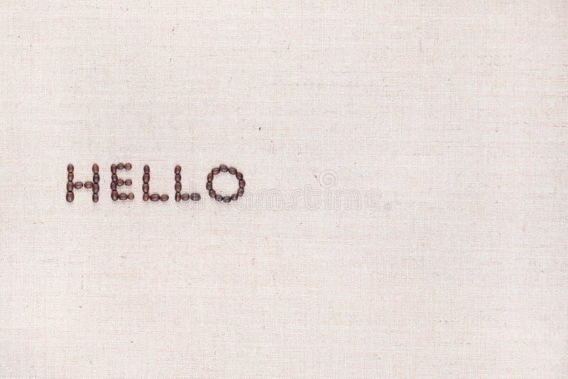 Le mot bonjour écrit avec des grains de café tirés d'en haut, aligné vers la gauche photos stock