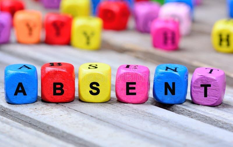 Le mot coloré absent sur la table photos libres de droits