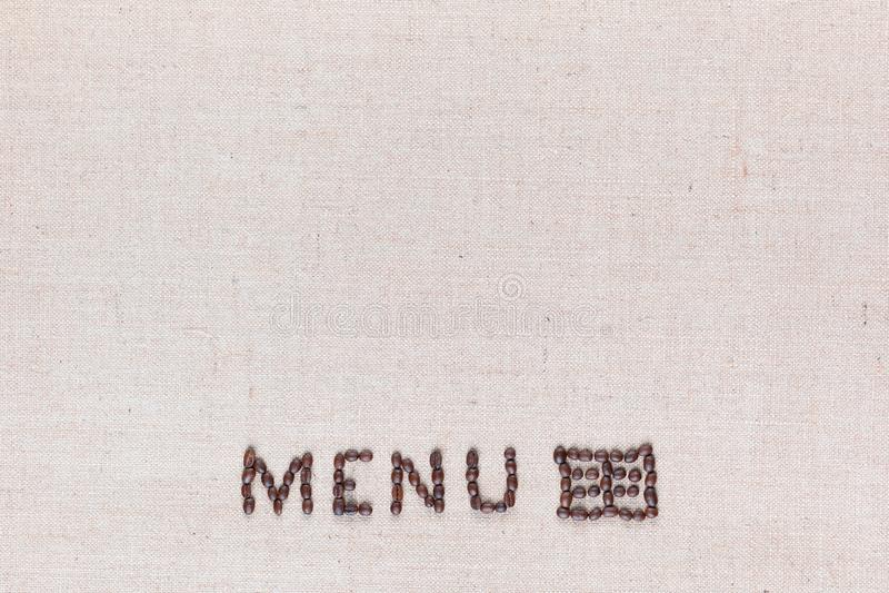 Le mot de menu avec l'icône faite à partir des grains de café rôtis sur la texture de toile, a tiré du centre inférieur ci-dessus image stock