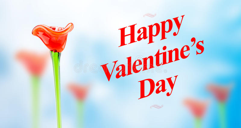 Le mot heureux de jour de valentines avec les gisements de fleur en verre rouges brouillent dessus a image stock