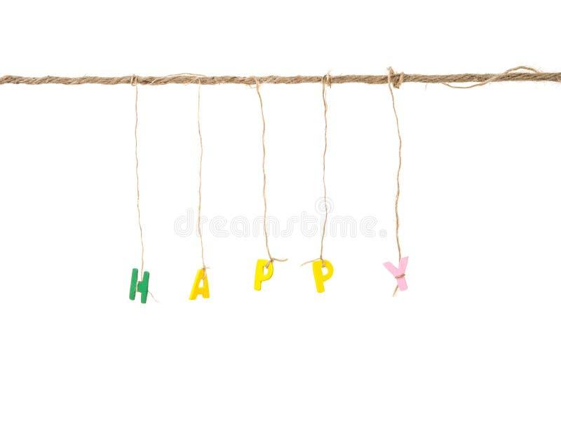 Le mot heureux en bois d'alphabet anglais binded par la corde image stock