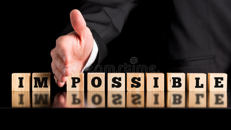 Le mot Im - possible sur les blocs en bois photo stock