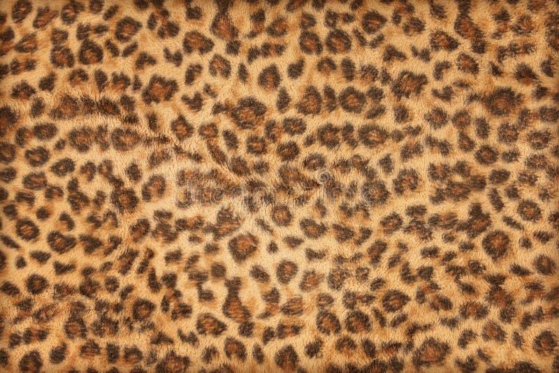 Le motif de tissu léopard pour l'arrière-plan et la texture photographie stock libre de droits
