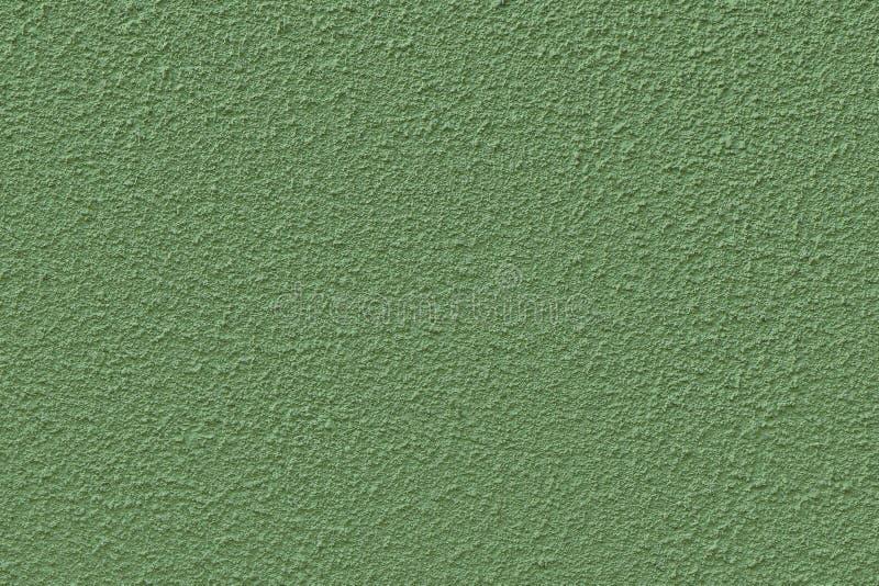 Le mur couvert de plâtre texturisé et de vert peint, texture sans couture photographie stock