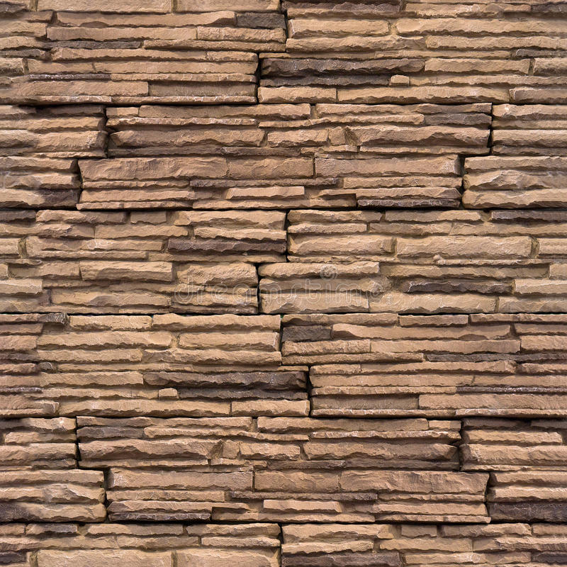 Le mur décoratif couvre de tuiles - fond sans couture - le modèle en pierre images stock