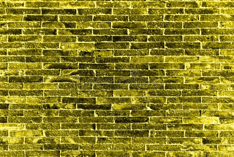 Le mur de briques jaune photo stock