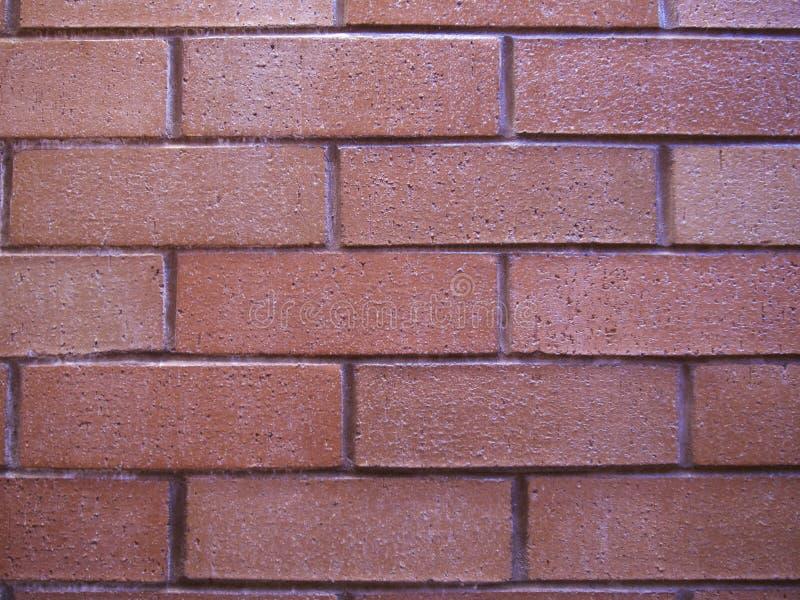 Le mur de briques, pierre, brique rouge de mur rouge a fait le fond cuire au four abstrait d'argile image libre de droits