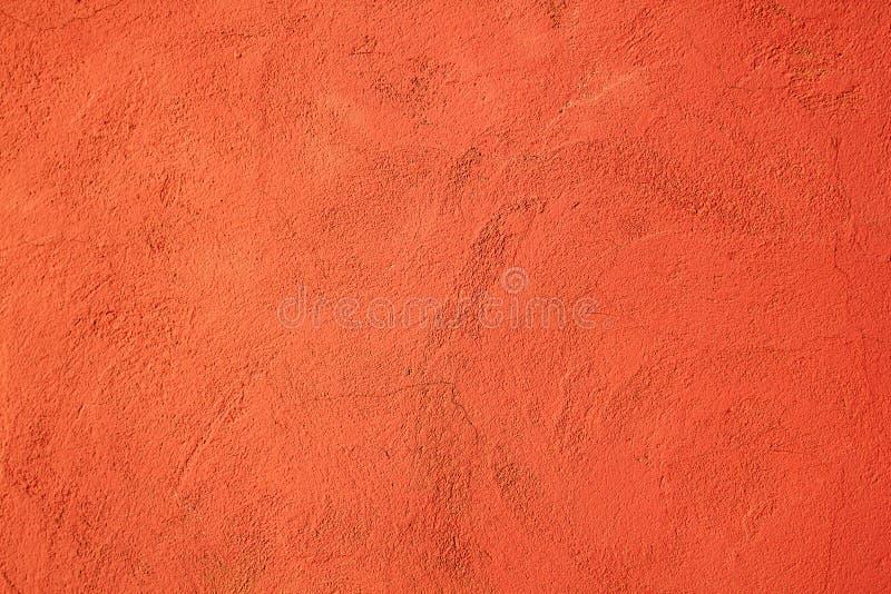 Le mur de ciment de fond a peint orange avec la texture image libre de droits