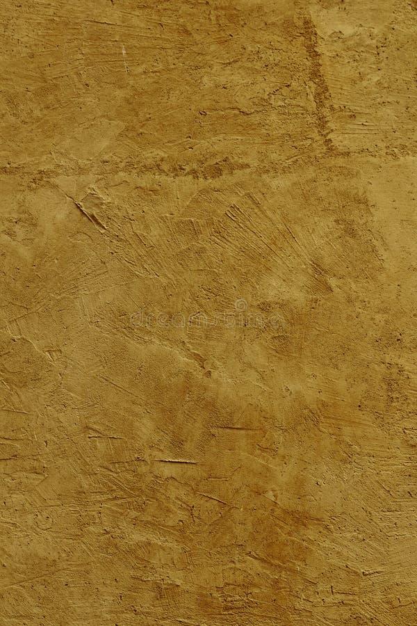 Le mur modifié la tonalité chaud de plâtre coloré par sienne de la terre s'est fermé en Sicile Italie photographie stock libre de droits