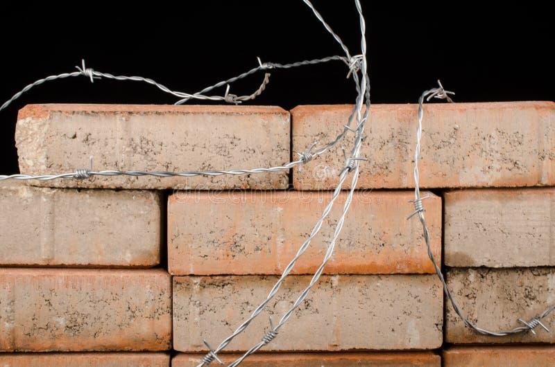 Le mur, un concept d'immigration photographie stock