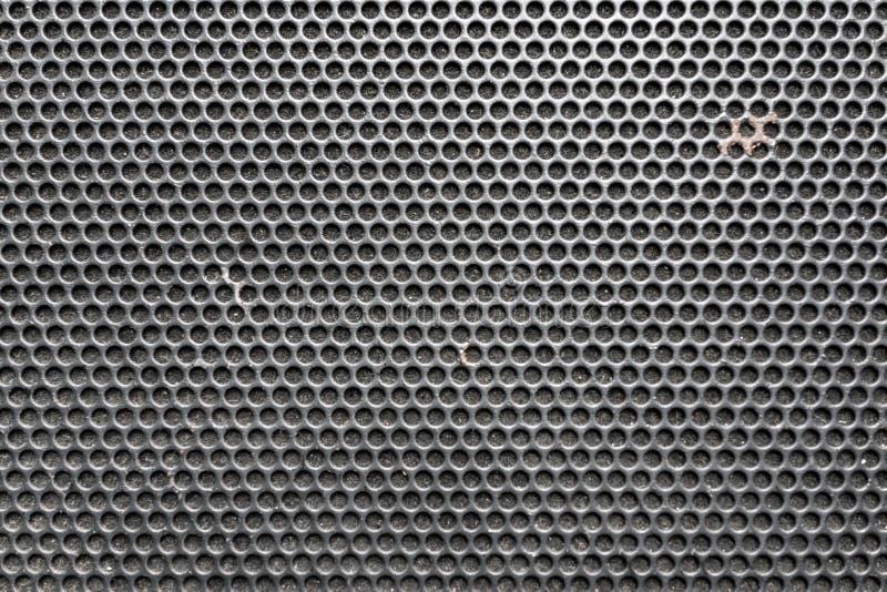 Le nid d'abeilles en métal a grillé le modèle devant le haut-parleur de musique comme CCB photo libre de droits