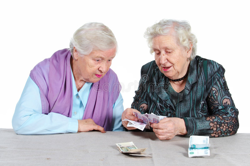Le nonne stanno contando i soldi. immagine stock libera da diritti