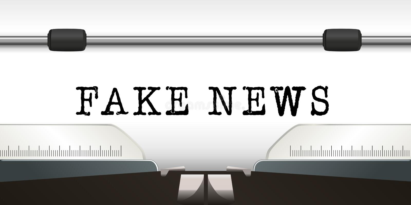 Le notizie false di parola sono di scrivere su uno strato bianco di una macchina da scrivere royalty illustrazione gratis