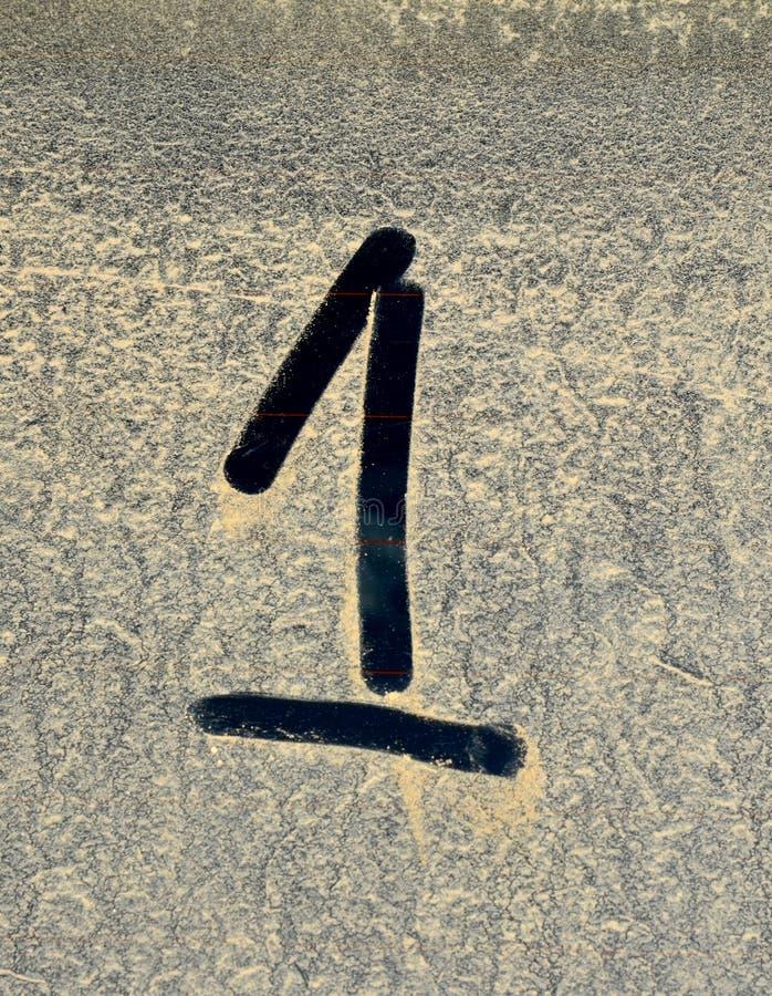 Le numéro poussiéreux un illustration stock