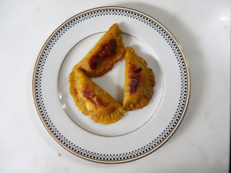 Le pâté en croûte traditionnel de platain de nourriture du Honduras a rempli de fruit ou de viande 3 photos stock