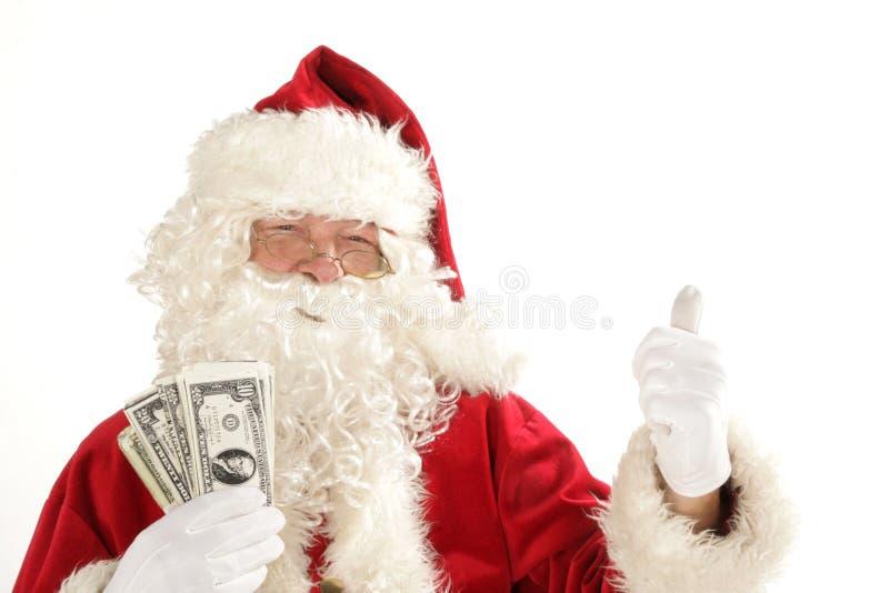 Le père noël avec l'argent comptant images libres de droits