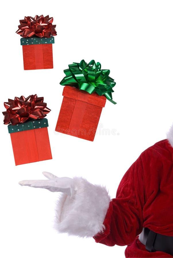 Le père noël avec le cadeau de flottement photo libre de droits