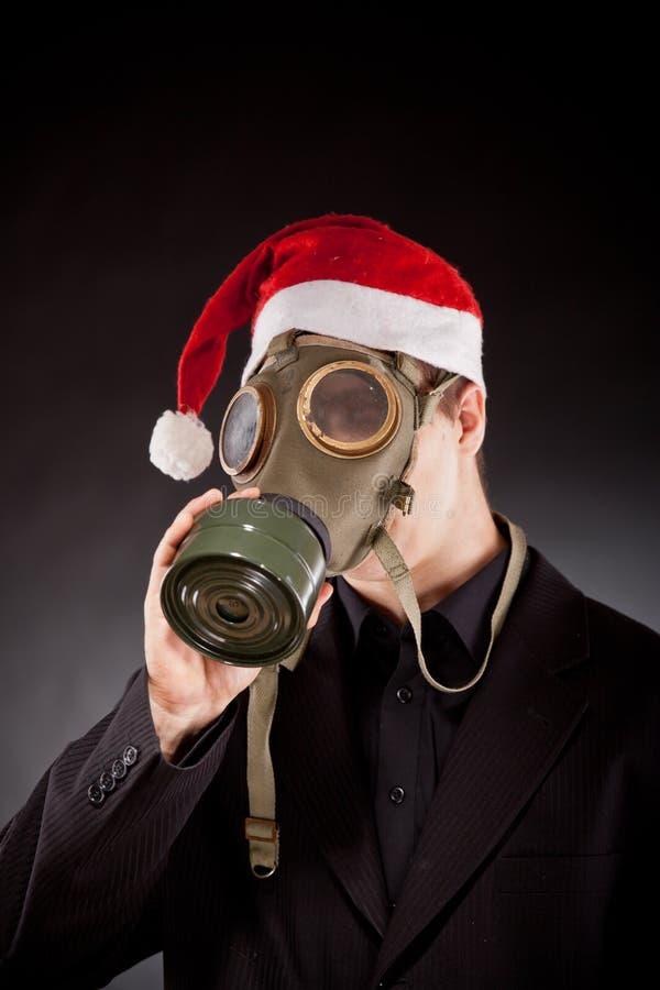 Le père noël avec le masque de gaz photographie stock libre de droits