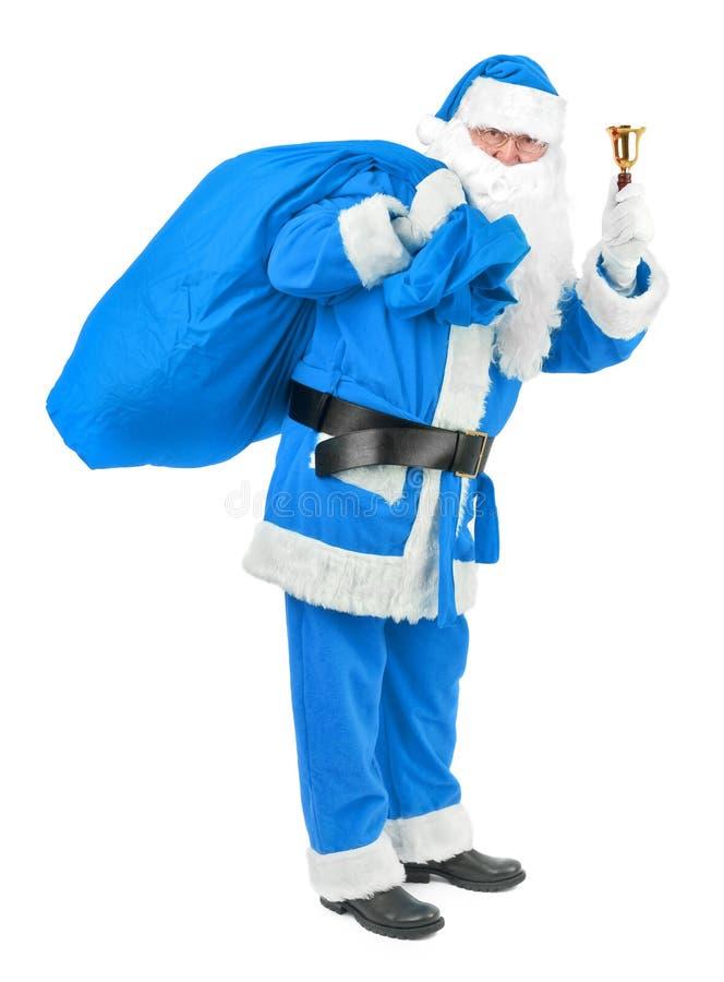 Le père noël bleu avec la cloche sur le blanc photos stock