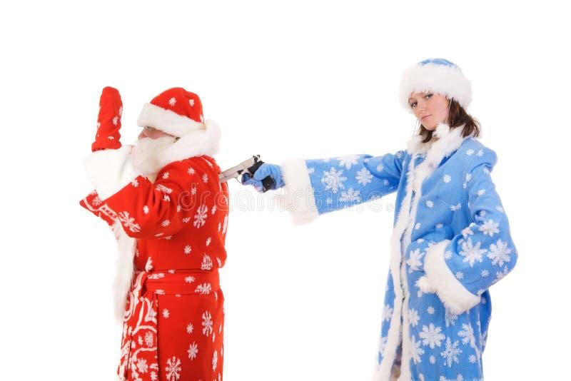Le père noël et fille de neige image stock