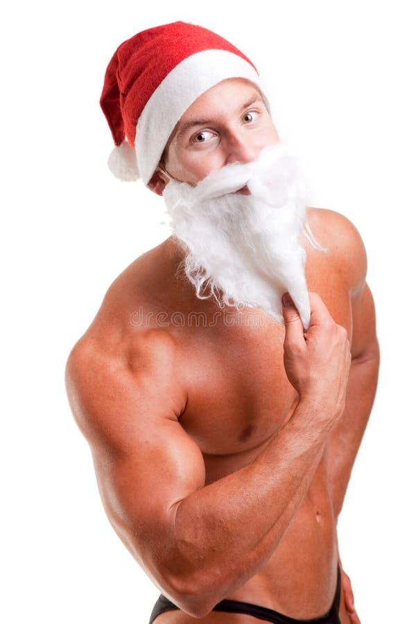 Le père noël musculaire image stock